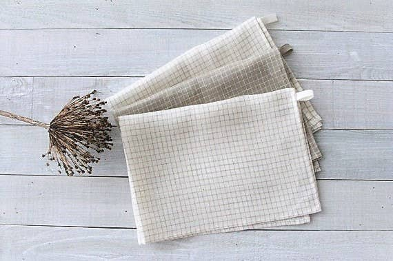 This set of dishcloths includes three linen towels — two white towels and one gray. Get it from MagicLinen on Etsy for $18.
