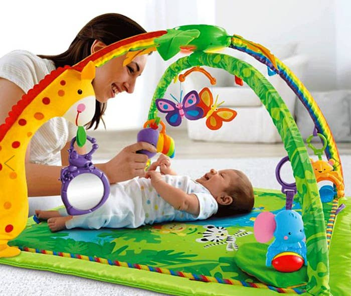 """Promising review: """"Let me be the first to say, my son has got to be held every waking moment of the day. At 2 months old he already knows who mommy is and will not stand to be put down. This toy gives me a good 45 minutes of free time at a time. He'll sit in this a good 4-5 times in a day, laughing and smiling, trying to talk to the toys. This is a life saver. Plus I love watching him play and have a good time."""" —ProudMotherOf1Price: $69.29 at Walmart"""