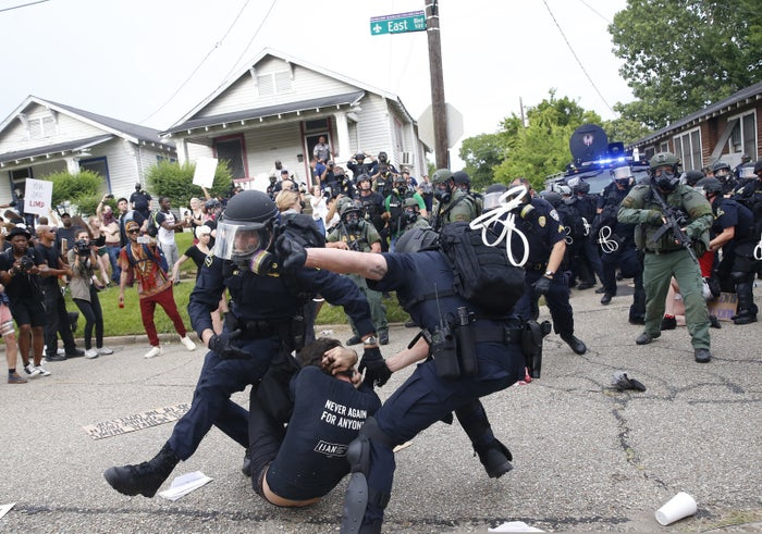 Police scuffle with a demonstrator as they try to apprehend him during a rally in Baton Rouge, Louisiana, on July 10, 2016.