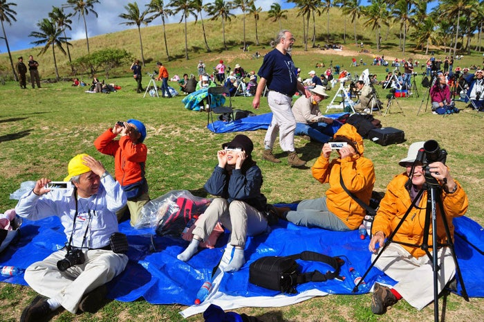 Tourists watch a solar eclipse from Easter Island in the Pacific Ocean, 3,700 kilometers off the Chilean coast, on July 11, 2010.
