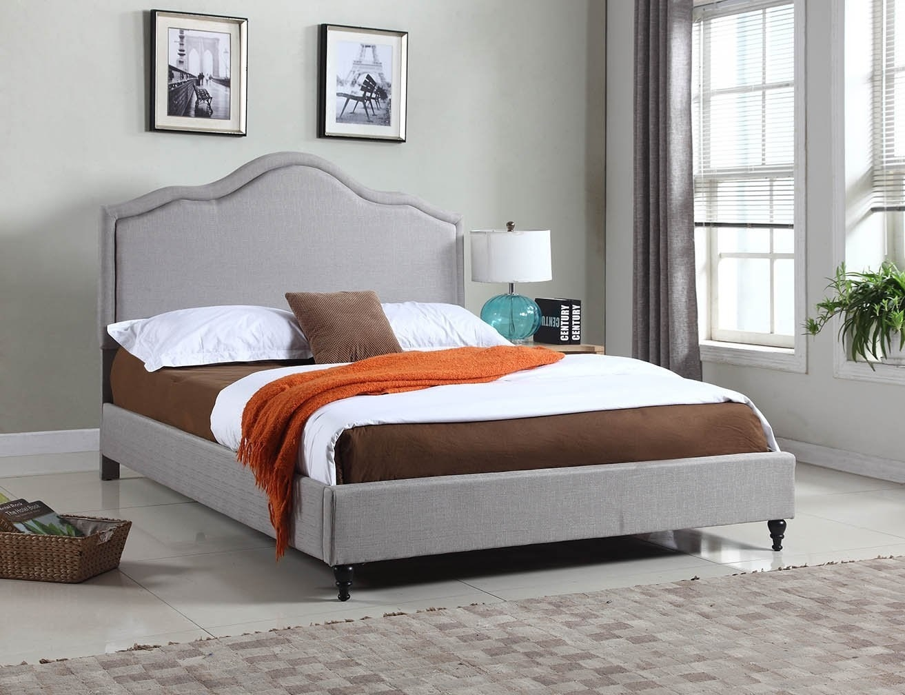 side view of the grey upholstered bed frame