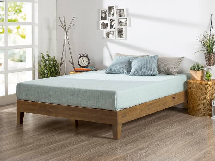 a wooden frame that becomes the focal point so you dont have to worry about decorating - Easy Bed Frame
