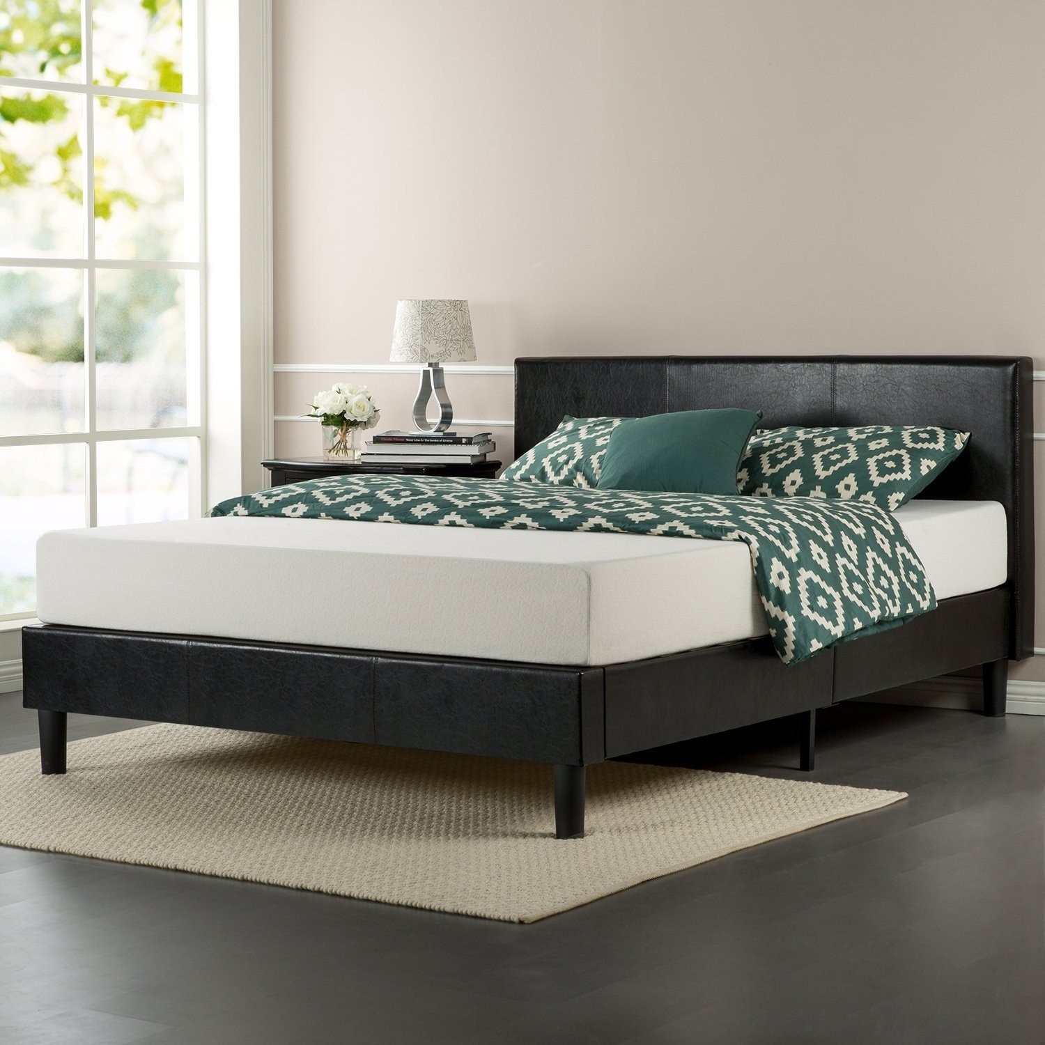 side view of the black faux leather bed frame