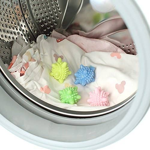 "Promising Review: ""These washing balls are amazing. Living on a farm and having a toddler, we have some pretty hardcore laundry. I was happy to find these balls!"" —AndreaGet a six-pack from Amazon for $7.99."