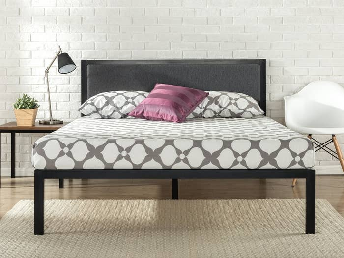 """Promising review: """"Great purchase, especially at this price. The headboard is really nice looking and the bed is sturdy AF. The instructions are super easy to follow and everything is clearly labeled. The frame has velcro along the edges so you can properly secure the wooden slats. The slats have portions that have non slip adhesive to keep your mattress from shifting. It was really easy to put together. I did it myself with a toddler crawling all over me in about 20 minutes."""" —Rdub17Price: $109.99 (available in sizes twin–king)"""