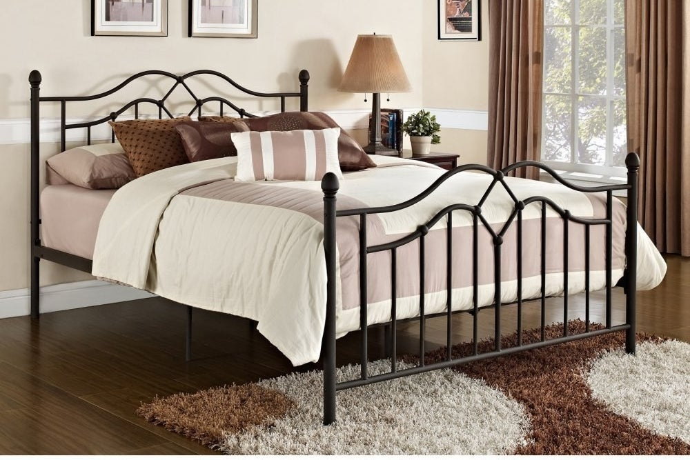 side view of the black metal bed frame