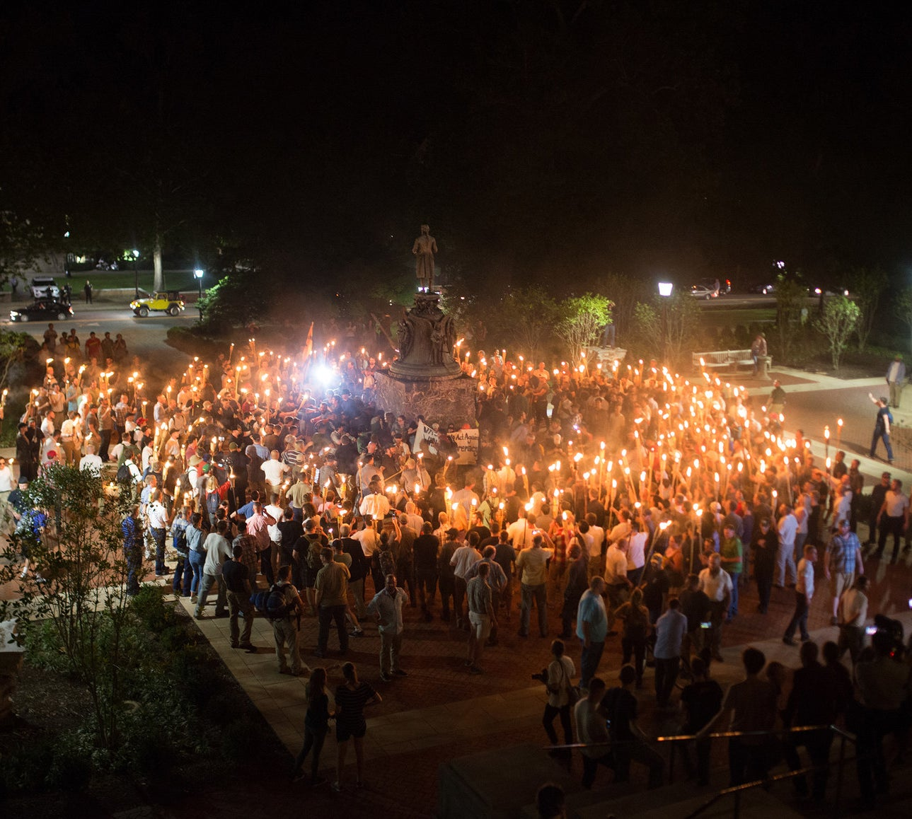 Protesters encircled counterprotesters at the base of a statue of Thomas Jefferson after marching through the University of Virginia campus on Friday night.