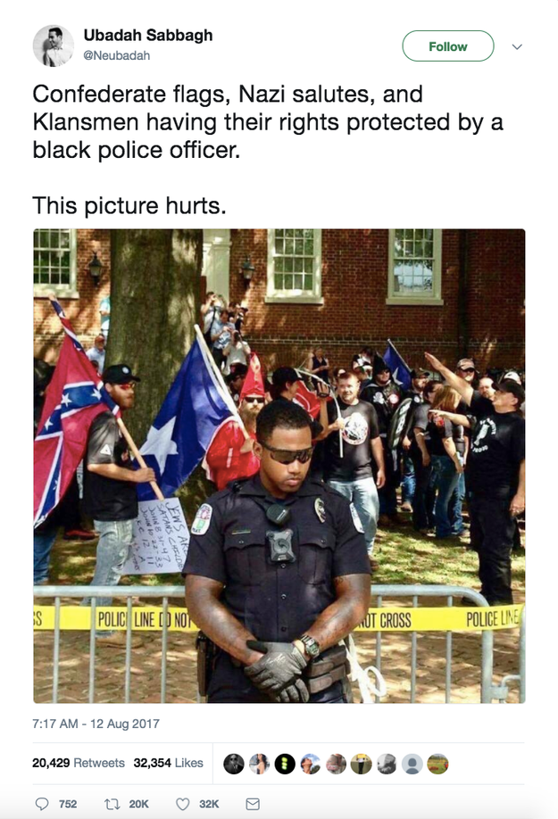 A photo being shared online that people are claiming shows a black police officer guarding Saturday's white supremacist rally in Charlottesville, Virginia, is actually an old picture from a rally in July.