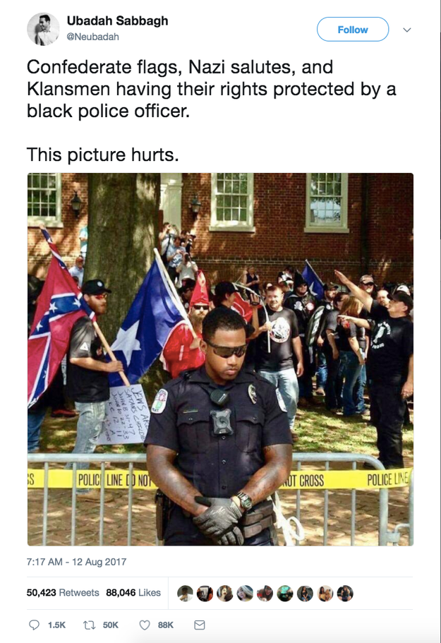 An image being shared online that people are claiming shows a black police officer guarding Saturday's white supremacist rally in Charlottesville, Virginia, was actually posted in July.