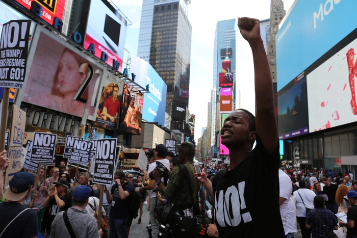 Protesters chant slogans against white nationalism in Times Square Sunday.