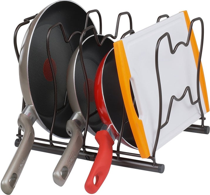 "Promising review: ""I was tired of stacking my frying pans on top of each other and was looking for something to both organize my pans and give me easy access to them. Before this organizer, I would have to unstack several pans in order to get to the middle pan that I needed. Now, I can just reach in and immediately get the frying pan that I need without having to unstack. The quality of this organizer is pretty good."" —Linda RobersonGet it from Amazon for $14.97 (available in two colors)."