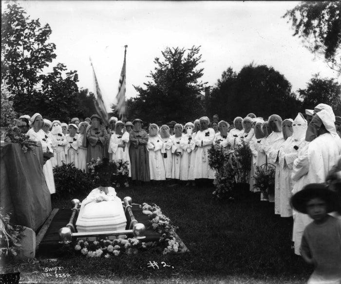 Kamelias (female KKK members) attend a funeral in Muncie, Indiana.