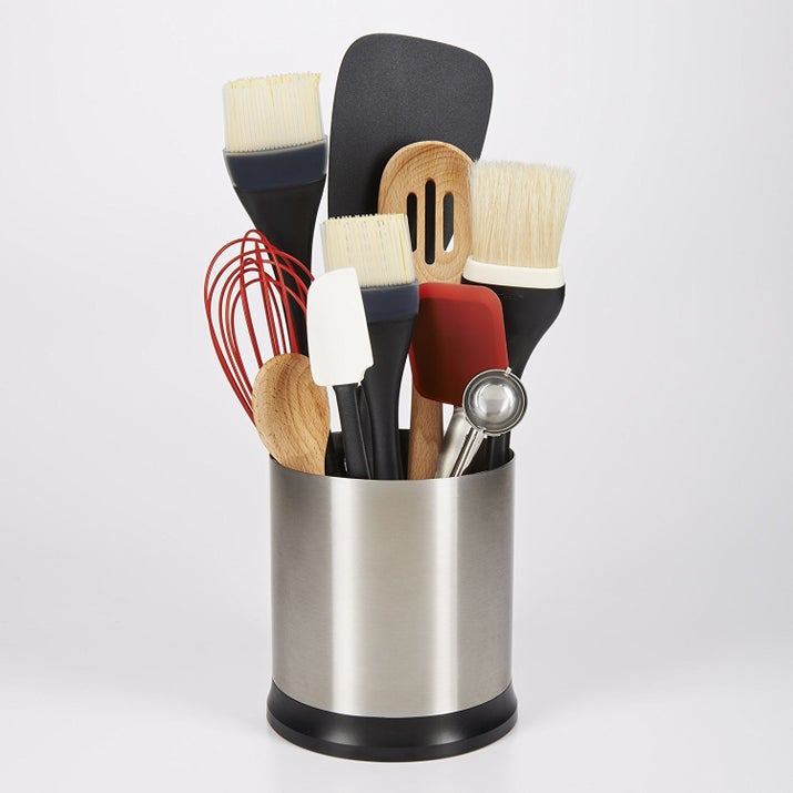 """Promising review: """"I cook a LOT. I had a utensil holder, but it wasn't big enough so it was hard to slide the utensils in — and if it was semi-empty, they were tilting and falling. I threw it away and used a drawer but then was super sick of digging through everything to get what I needed, especially when you have something on the stove and you need it pronto. I ordered this and love it. It rotates so you can spin it around to get what you need really quickly, has three dividers in it (so the utensils aren't falling over every time you pull one out), and is big enough to fit everything. I have maxed it out with all my utensils — I have 16 cooking utensils in it at a time. It also looks really nice and sleek on the counter. I highly recommend this product."""" —JessieGet it from Amazon for $19.99."""