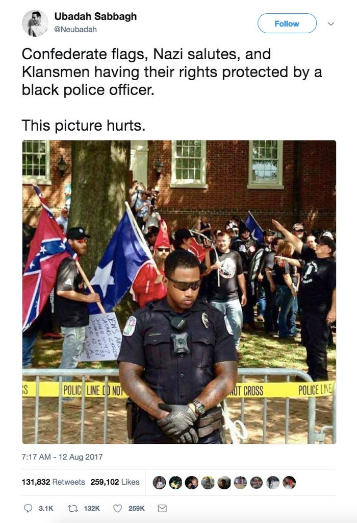 This tweet from Saturday, which already has over 100,000 shares, shows a picture of a black cop standing in front of a white supremacist rally and incorrectly claims it's from Saturday's rally.