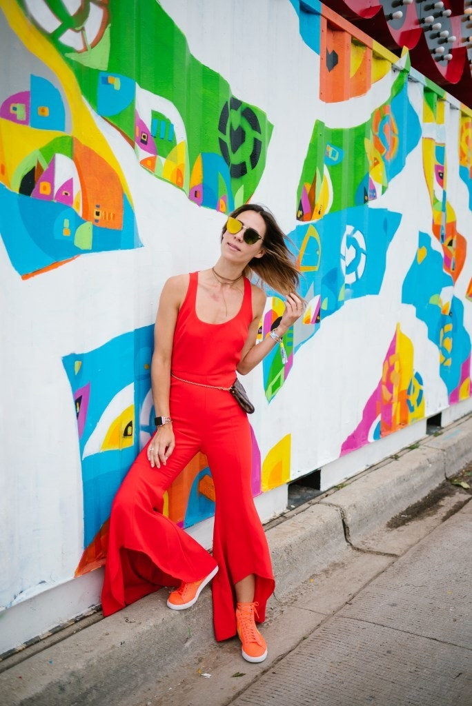 While not your typical dress this red jumpsuit is sure to make a statement. Especially when you pair it with some killer Nikes.
