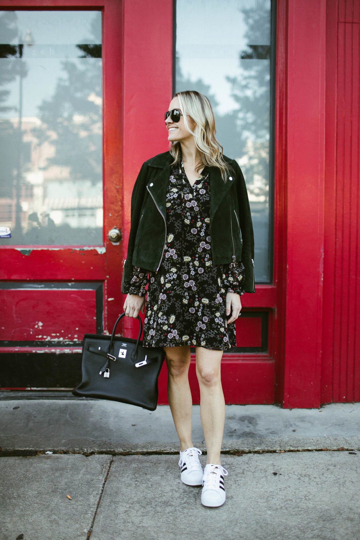 When you pair a floral shift dress with some sporty Adidas' and a leather jacket you get an outfit perfect for an urban setting.