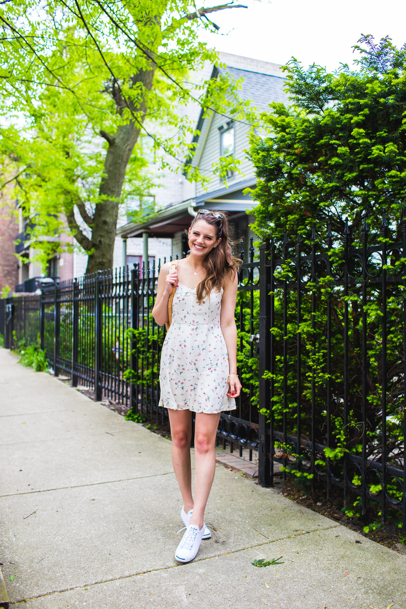 Pair a floral, feminine dress with classic low tops and you've got yourself a cute summer outfit.