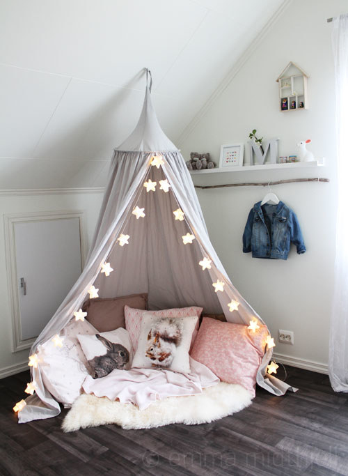 Create The Reading Nook Of Your Dreams By Lining A Hanging Canopy With Star Shaped  String Lights. Donu0027t Forget The Cozy Faux Sheepskin Rug For The Ultimate ...