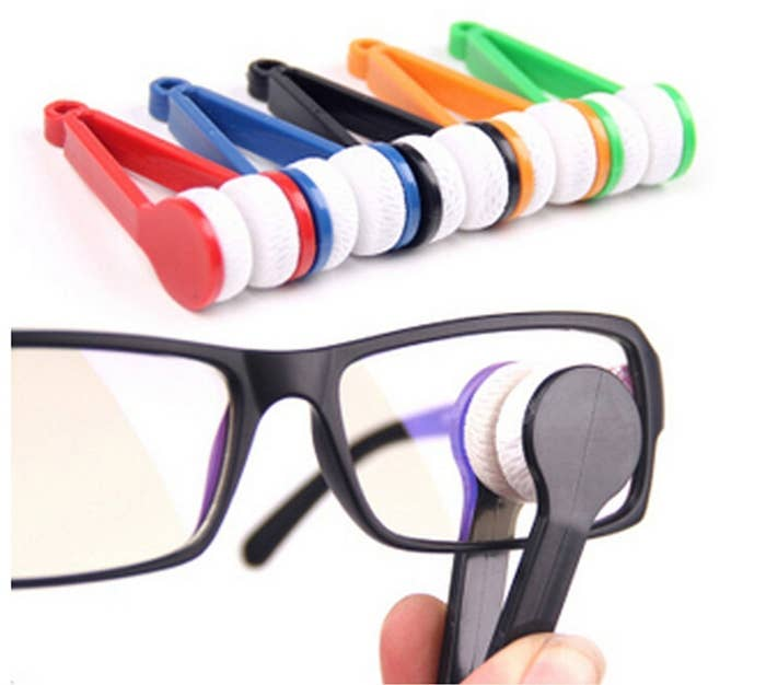 """Promising review: """"Twitter, yes Twitter is where I found the recommendation for these glasses cleaners. I want clean glasses, and one of my current pairs attracts more dirt than any other pair of glasses I have owned. I do not know why, I only want them clean. I purchased this set, the microfiber cleaner comes in five different colors, if that is an issue for you. The little microfiber piece fits perfectly between the front and back of your glasses, so both sides are cleaned at once. I still use the spray once or twice a day, but I keep these with me at all times. Clean glasses abound."""" —prisrobGet a five-pack from Amazon for $6.19."""