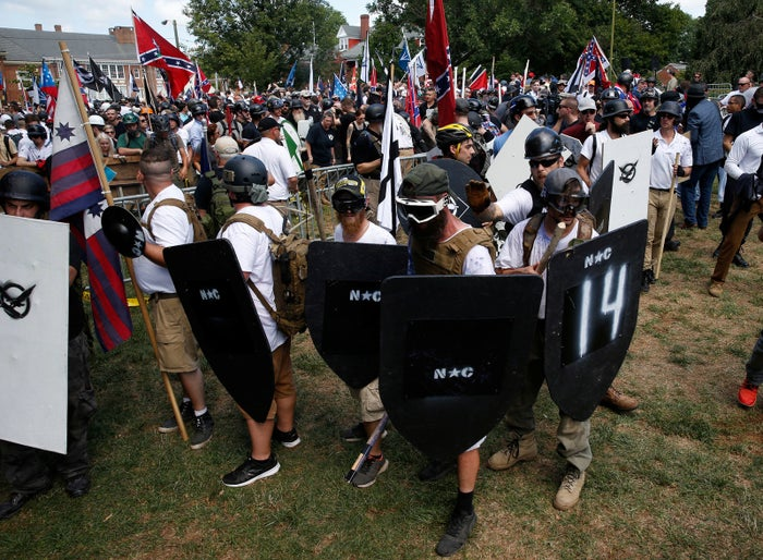 Members of white nationalist protesters hold shields as they clash against a group of counter-protesters in Charlottesville, Virginia, on August 12.