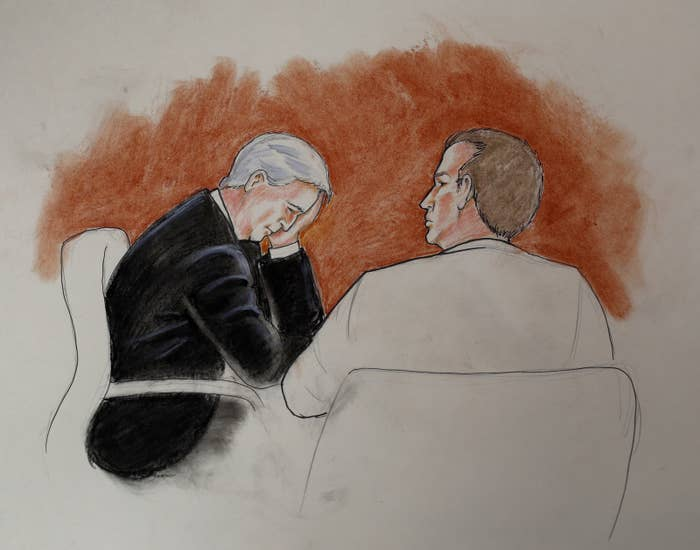 David Mueller, left, sits with his attorney in this courtroom sketch.