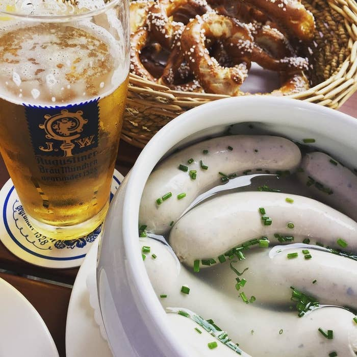 """Having white sausage with sweet mustard, beer and pretzels for breakfast is kind of a national treasure in Bavaria. The only true way of eating the sausage is to suck it out. Yes, seriously. It's called """"zutzeln""""."""