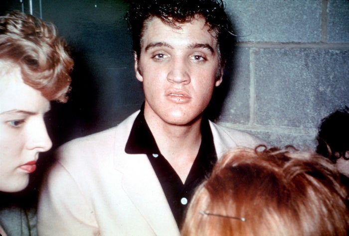 Elvis greets fans backstage after performing in Cleveland on Oct. 19, 1955.