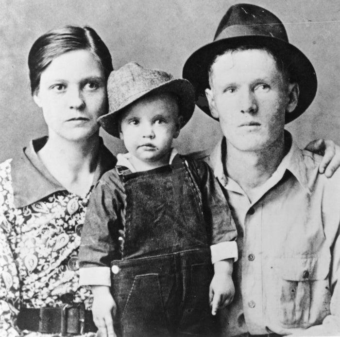 Elvis Presley poses for a family portrait in 1937, with his parents, Vernon Presley and Gladys Presley, in Tupelo, Mississippi.