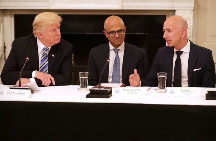 Amazon CEO Jeff Bezos speaks to President Trump at a White House meeting in June.