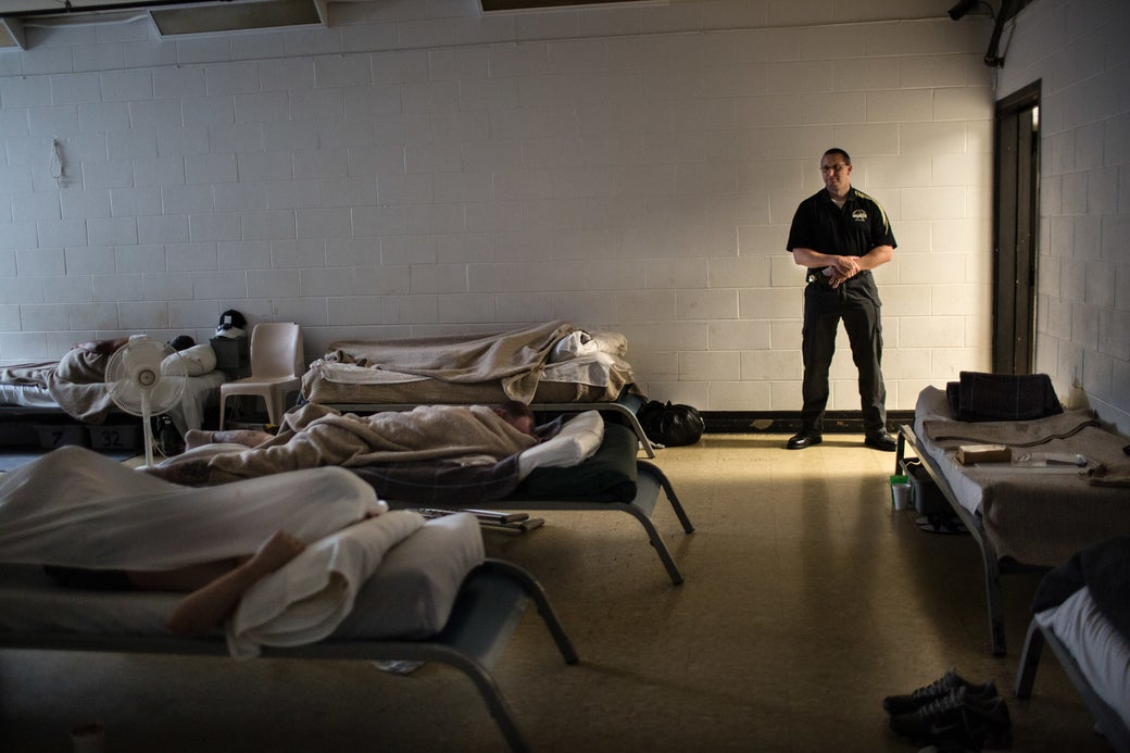 Lt. Charles Udischas stands guard in Coshocton County Jail's recreation room, where inmates sleep because of overcrowding.