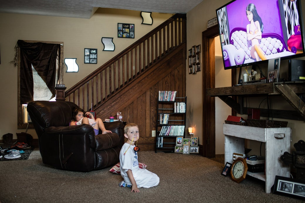 Halley and Holton Conley watch TV at home. Their mom, Stephanie, was a heavy drug user who went through Family Drug Court to recover from addiction and get her children back.