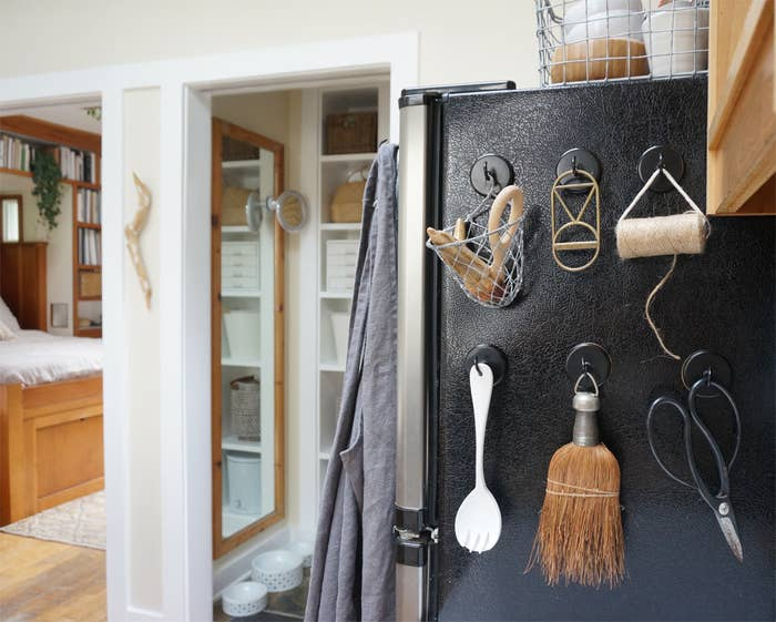 When considering her budget for her kitchen renovation, Morris realized she couldn't afford to change both the counters and the appliances. Despite not loving her fridge, she decided to keep it and pursue some creative solutions —such as these hooks — for helping it blend into the general aesthetic. Get them from Amazon for $9.29.
