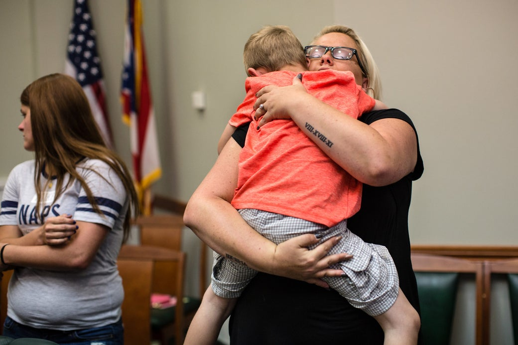 Stephanie Conley hugs her son, Holton, during her graduation from Family Drug Court.