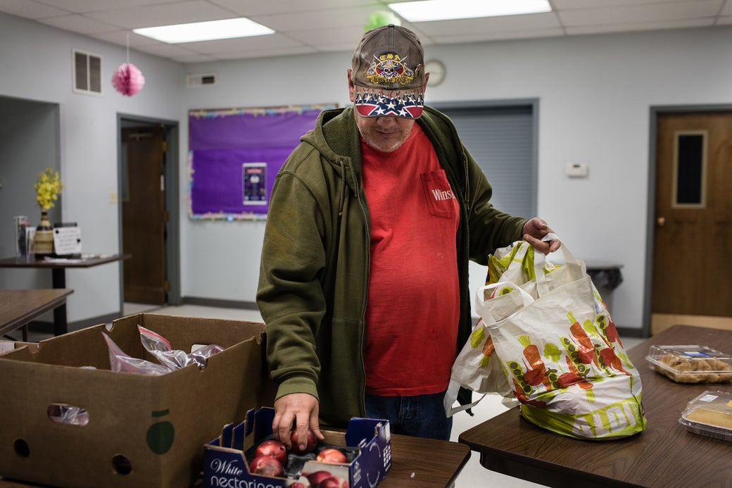 Richard Kobach in the Salvation Army's bread room, a free food service for the county's low-income residents.