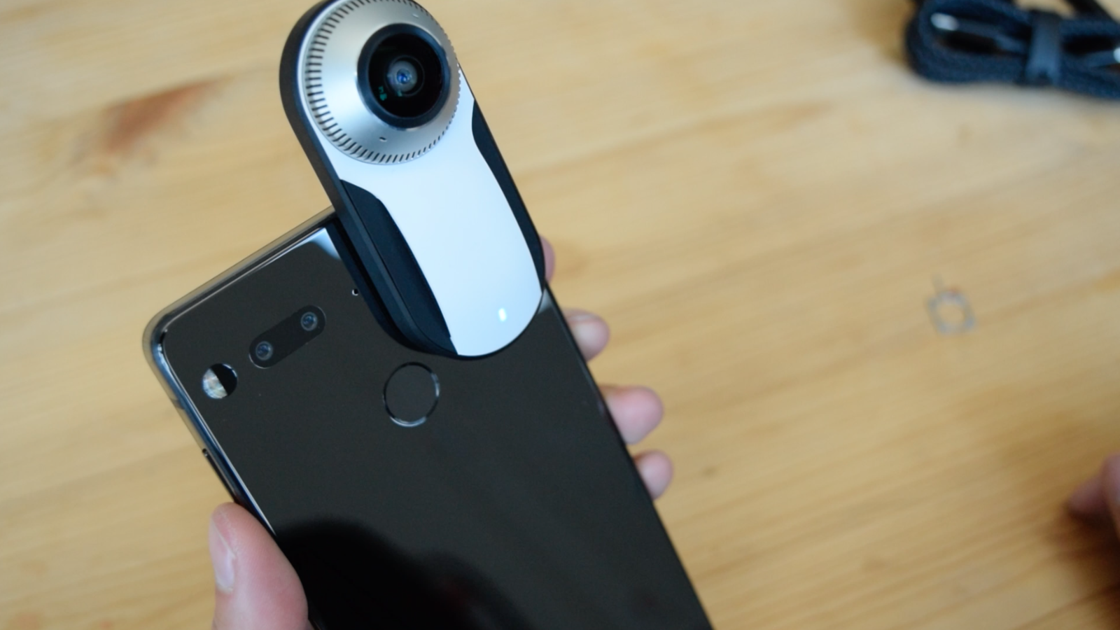 "The camera, which is sold separately for $200 (or $50 if you buy it with the phone), snaps to the phone through magnetized, metal prongs. According to Essential, it's the ""world's smallest 360º personal camera.""After you connect the camera, it immediately launches 360º mode in the camera app. I tried a not-yet-finalized version of the 360º cam and app, so sometimes the app launched automatically, sometimes it didn't. The camera can capture 2k or 4k photos or video and doesn't have flash, so you're limited to day photography. The accessory has two 180º cameras, one on the front and one on the back, and the two images are stitched together automatically on the phone itself. It puts in a lot of work for small device. You can hear the fan inside of the 360º camera working, and the phone runs warm while processing 4k images.When it officially launches, Essential's camera app will also be able to support 360º livestreaming to Facebook, YouTube, and Twitter."