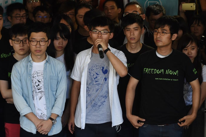 Joshua Wong, center, Nathan Law, left and Alex Chow.