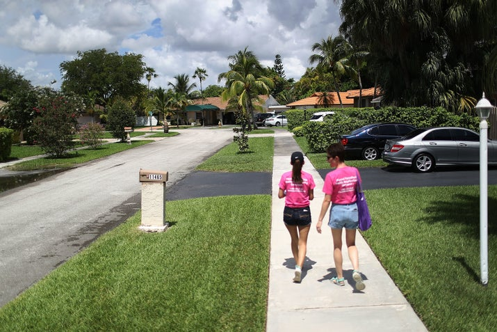Planned Parenthood canvassers go door to door about the Zika virus in Florida last month.