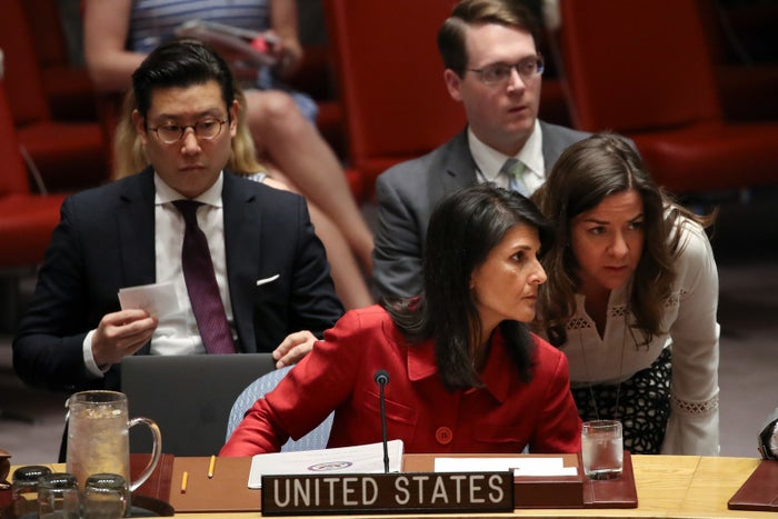 Nikki Haley, US ambassador to the UN, confers with an aide.