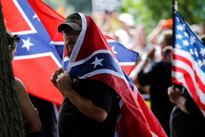 Members of the Ku Klux Klan rally in opposition to city proposals to remove or make changes to Confederate monuments in Charlottesville, Virginia.
