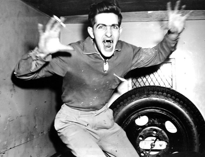 William Patrick Farrell, 25, screams and lunges toward a photographer in a police van on March 3, 1955. Farrell was arrested for the murder of an NYU student named Ann Yarrow the month before.