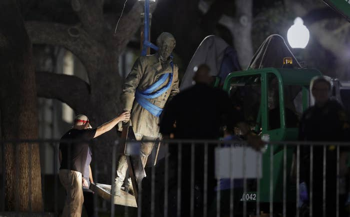 A statue of Confederate Gen. Robert E. Lee is removed from the University of Texas campus early Monday morning.