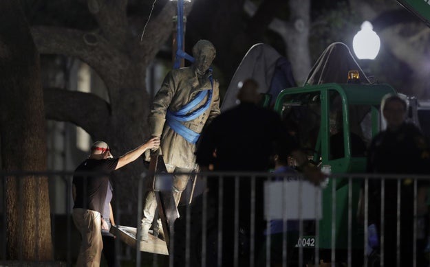 The University of Texas at Austin abruptly took down four Confederate statues — including one of Gen. Robert E. Lee — on a prominent part of the campus early Monday morning.