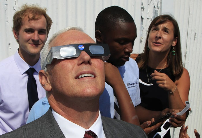 Pence watching the eclipse on Monday.