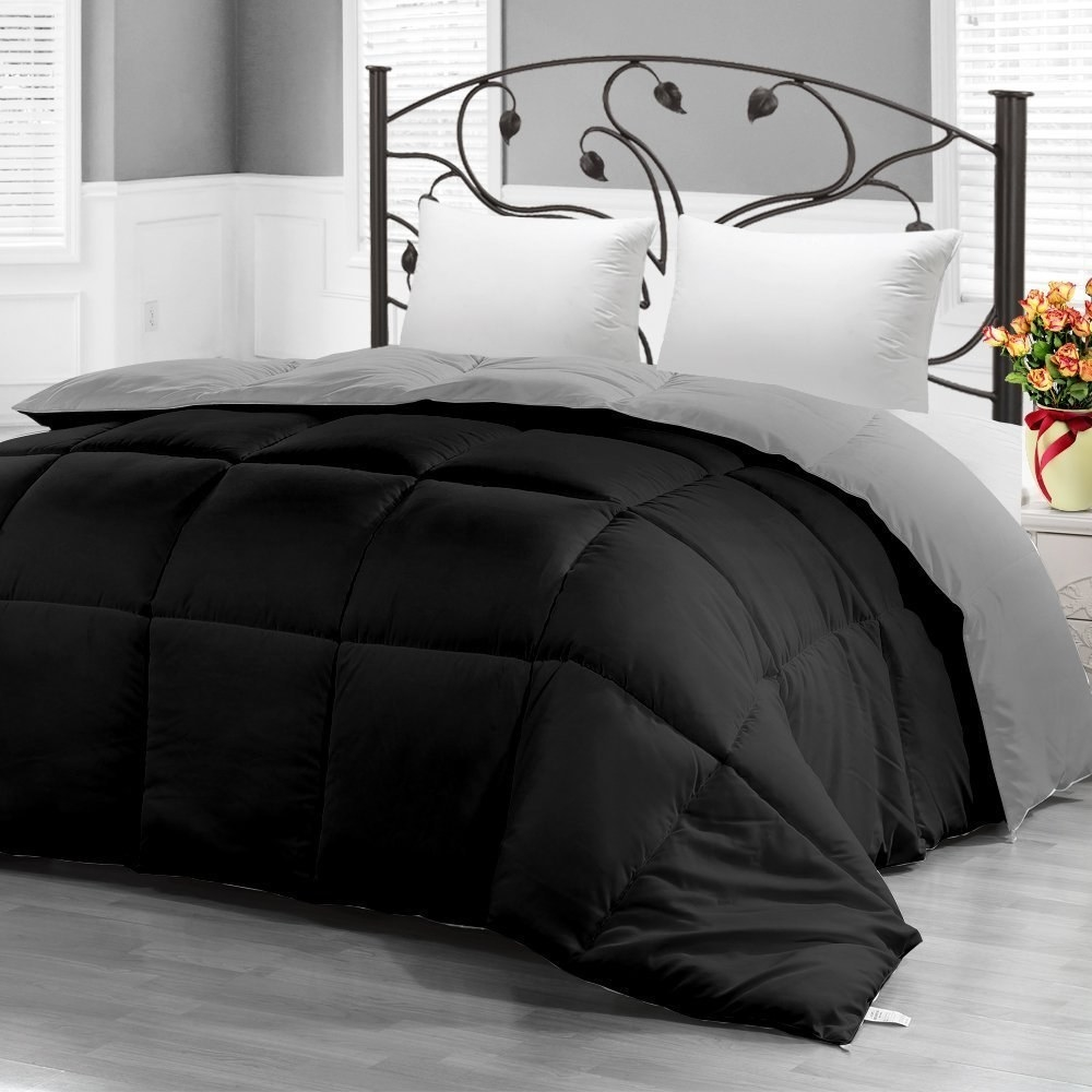 Black comforter on mattress in bedroom