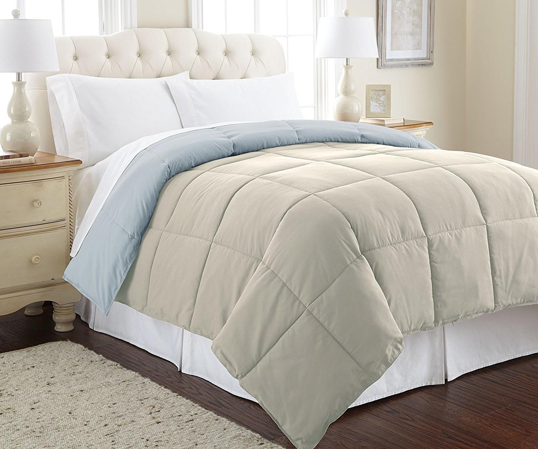 Beige comforter on mattress in bedroom
