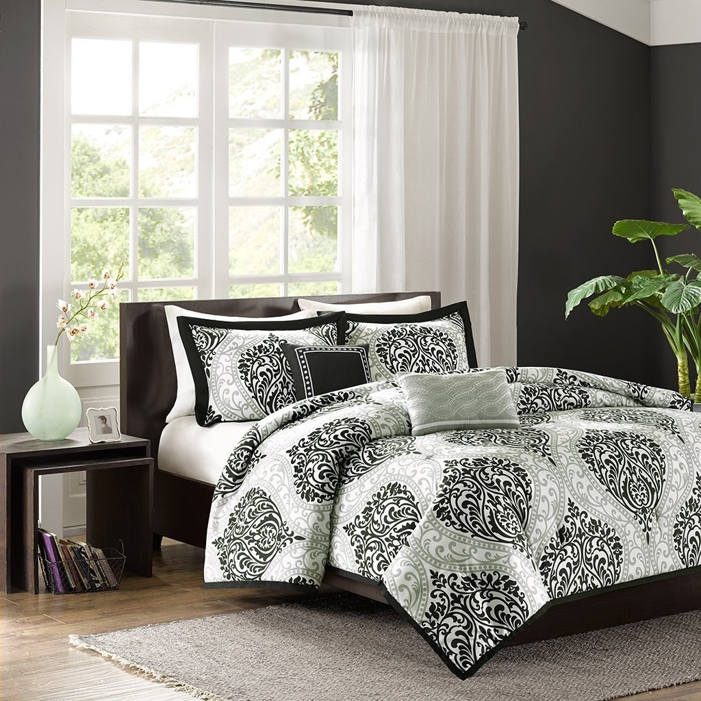 Patterned comforter on mattress in bedroom