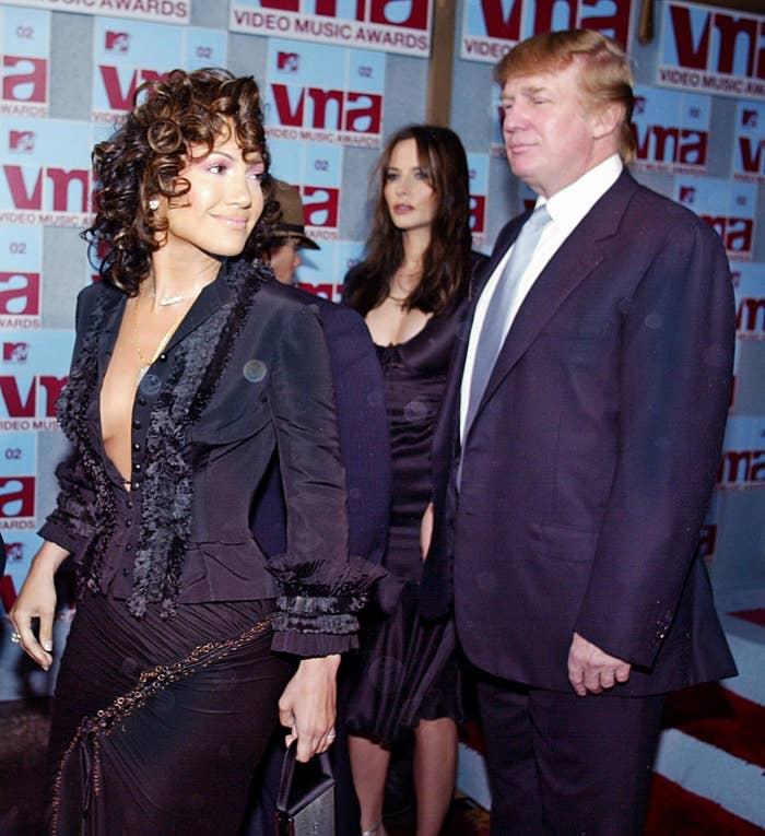 2 Donald And Melania Trump Stood In The Shadows Of Jennifer Lopez Were Covered Orbs Foreshadowing Worlds Spooky Future