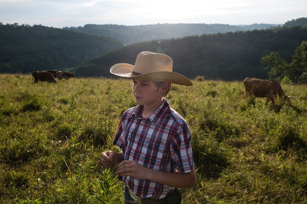 Lane Morris, 14, and his family's longhorn cattle.