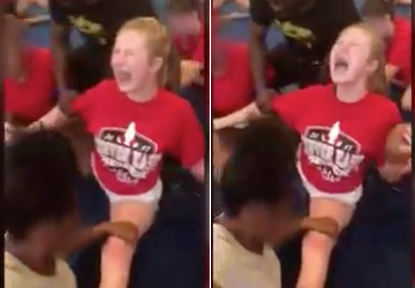 The footage shows Ally Wakefield being held down by her fellow East High School cheerleaders and coach at a June training camp as she screams in pain.
