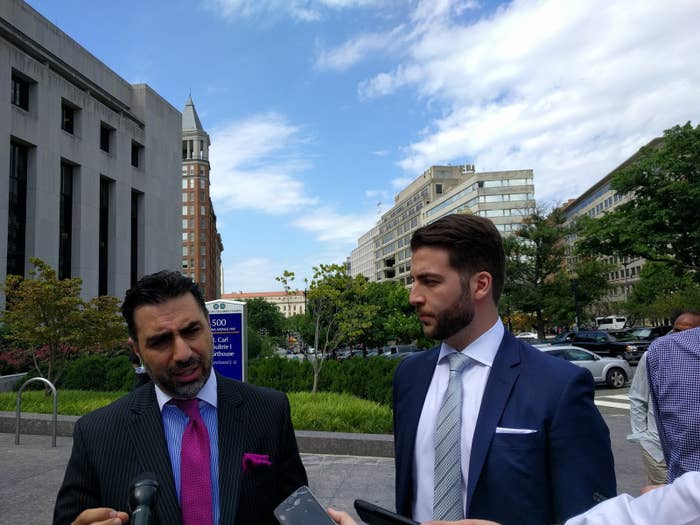 DreamHost's lawyer Raymond Aghaian (left) and Chris Ghazarian speak with reporters outside DC Superior Court.